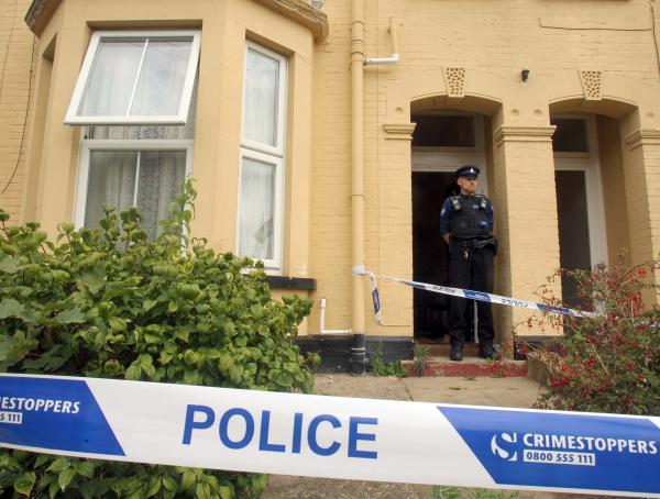 Man dies after collapsing in front garden