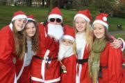 Santas Rebecca Mahoney,Megan Deakin,Tony,Grace and Gabby Dettman,Libby Frost in costume for the run