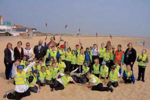 Schoolchildren fill up bags full of rubbish during beach clean as junior wardens
