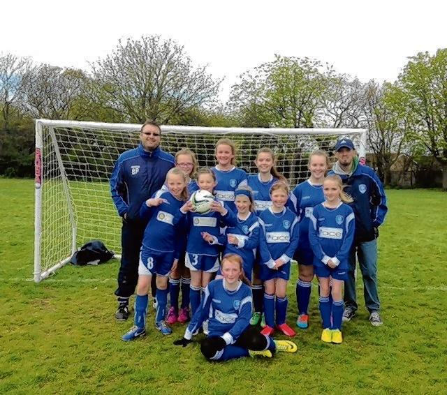 A CREDIT TO THEIR CLUB: Frinton's girls' team with coach Ben Pratt (far left) and manager Tom Vousden (far right).