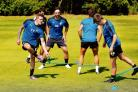 Back in the groove - U's players Sammie Szmodics (17), Jamie Harney (26) and Tom Lapslie on the first day of pre-season training at Five Lakes. Picture: SEANA HUGHES (CO108276-04)