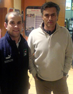 I'm not lovin' it - a slightly moody Jose Mourinho poses for a picture with Clacton Town FC's Sean Hillier