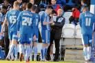 Discussion - Colchester United manager Kevin Keen talks to his players during his side's 4-1 defeat against Spurs. Picture: STEVE BRADING
