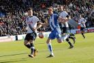 Battle - Colchester United captain Chris Porter tries to find a way past Spurs defender Kevin Wimmer during the FA Cup tie between the two sides, last weekend. Picture: STEVE ARGENT CO114334_0269