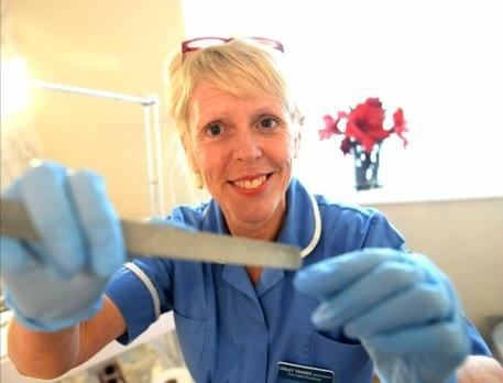 Footcare specialist Lesley celebrates award for looking
