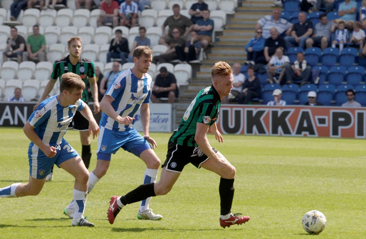 Giving chase - Colchester United midfielder Tom Lapslie (left) and team-mate Chris Porter attempt to win back possession against Rochdale. Picture: NIGEL BROWN