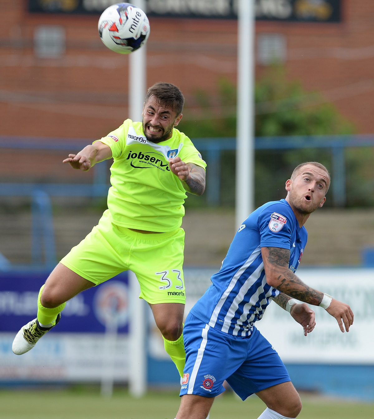 Eye on the ball - Lewis Kinsella (left) wins a header during his Colchester United debut at Hartlepool United. Picture: WARREN PAGE