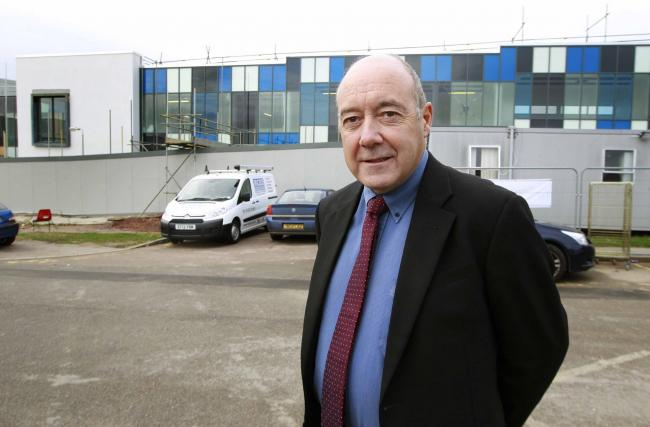 Committed - Dr Phliip Murray in front of the radiotherapy centre at Colchester General Hospital in 2013