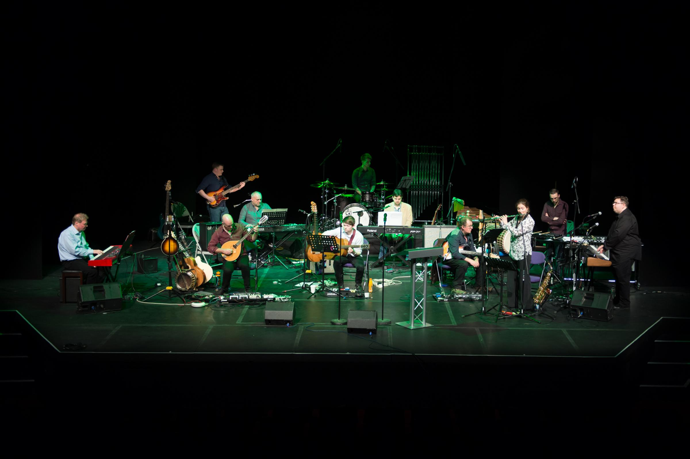 Phil Toms with his orchestra for the Tubular Bells concert at the Mercury Theatre - Photo by Henrik Colding Nieman.