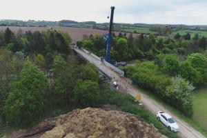 WATCH: Drone captures giant crane working to replace bridge