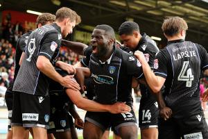 Celebration time - George Elokobi celebrates with his Colchester United team-mates following Macauley Bonne's goal at Leyton Orient. Picture: RICHARD BLAXALL