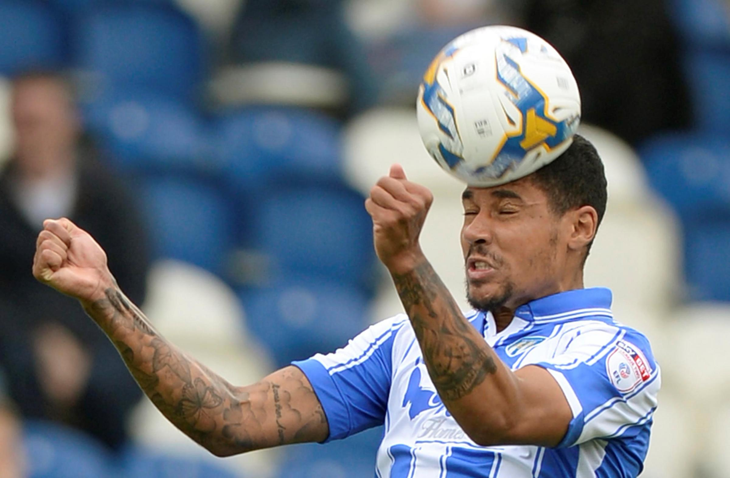 Heading in the right direction - Alex Wynter is hoping to help Colchester United beat Yeovil Town and secure a play-off place tomorrow. Picture: STEVE BRADING