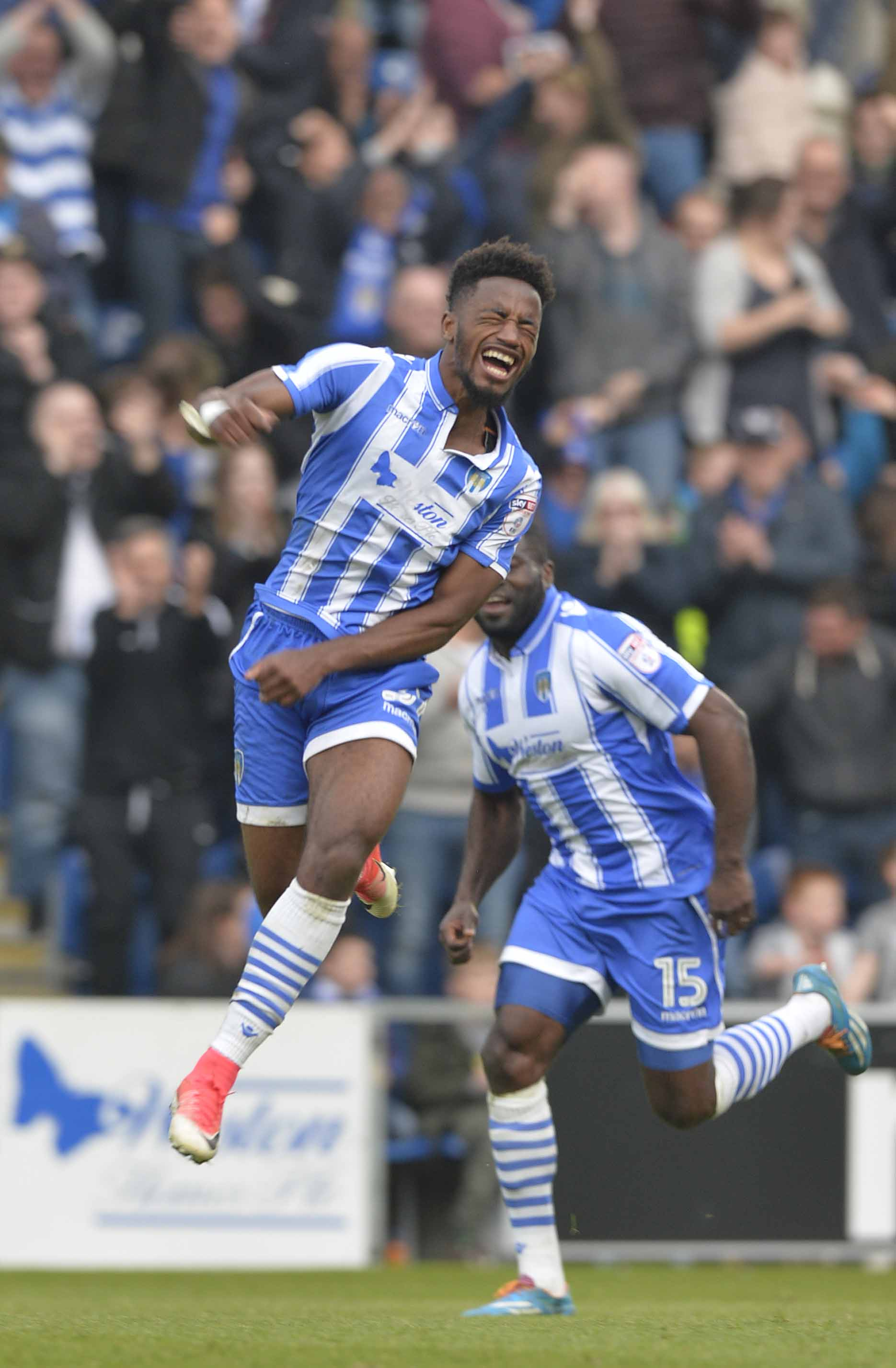 On the up - Tarique Fosu celebrates the second of his two goals for Colchester United against Yeovil Town on the final day of the League Two season. Picture: STEVE BRADING