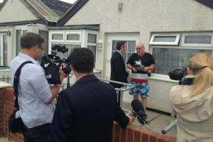Fanfare - reporters look on as Ukip candidate Paul Oakley speaks to voter Roy Traill, of Jaywick
