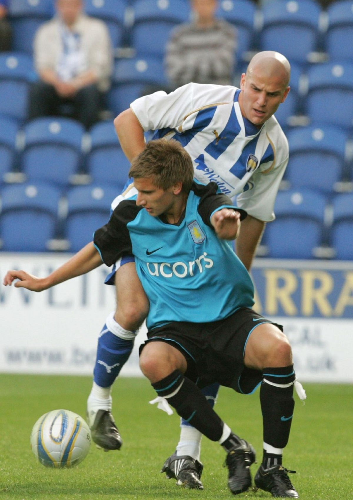Tussle - Colchester United's Marc Tierney takes on Aston Villa winger Marc Albrighton during the friendly between the two sides, in 2009.