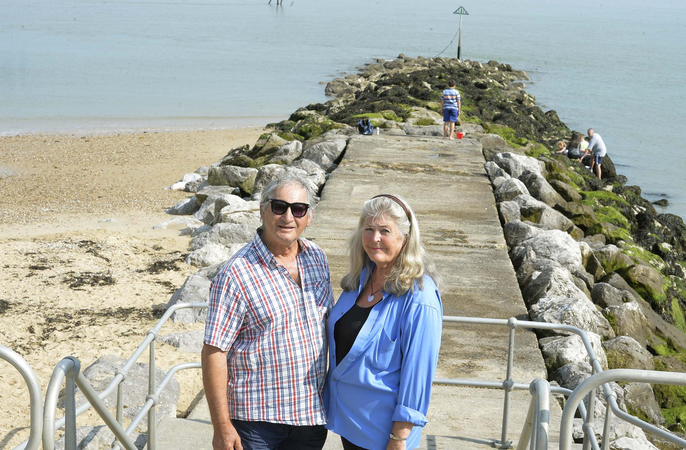 MORE WARNING: Sea swimmer Rodney Larner and his wife Irene at the waste outlet pipe on Eastern Terrace, Walton