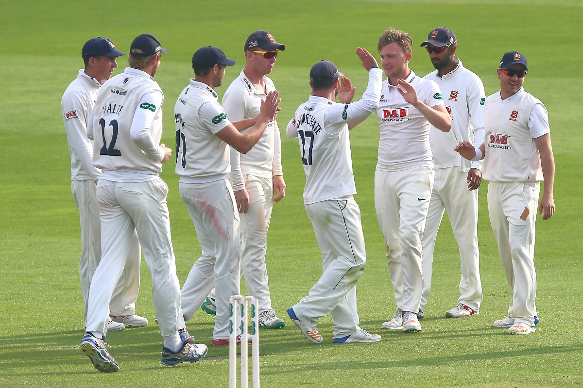 Starring role - Essex's Sam Cook is congratulated by his team-mates after taking the wicket of Jack Leaning Picture: GAVIN ELLIS/TGSPHOTO
