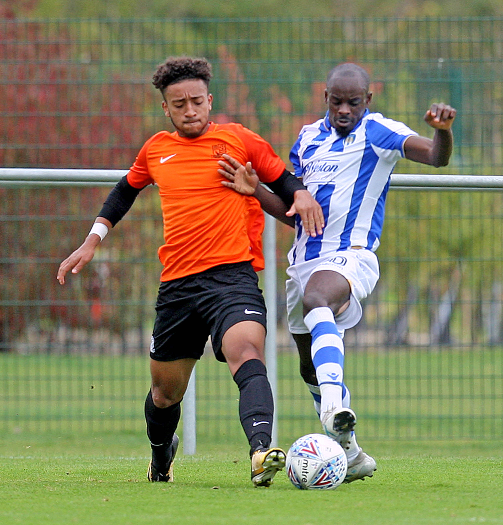 Battle - Sanmi Odelusi (right) competes for possession during Colchester United's Central League Cup group match against Southend United at Florence Park Picture: NICKY HAYES PHOTOGRAPHY