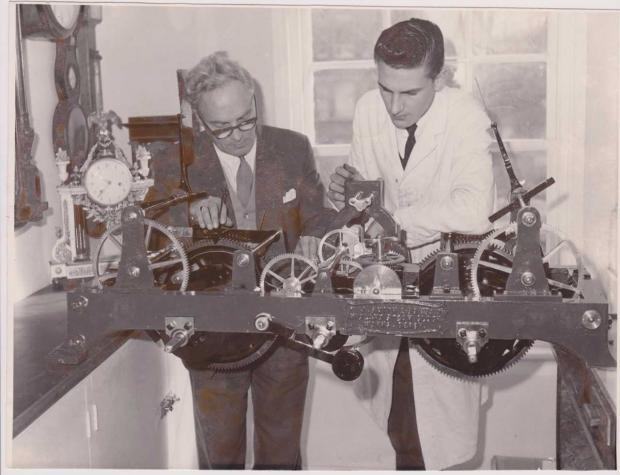 Gazette: Experts - Reginald Upchurch (left) and Michael Drew, examining the turret clock from St Michael's Church, Myland, in 1961