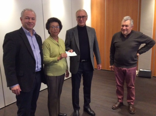 Cheque - Campaign chairman Peter Wilson (second right) with Rotary Club members Mark Howell, Helen Chuah and Austin Hicks