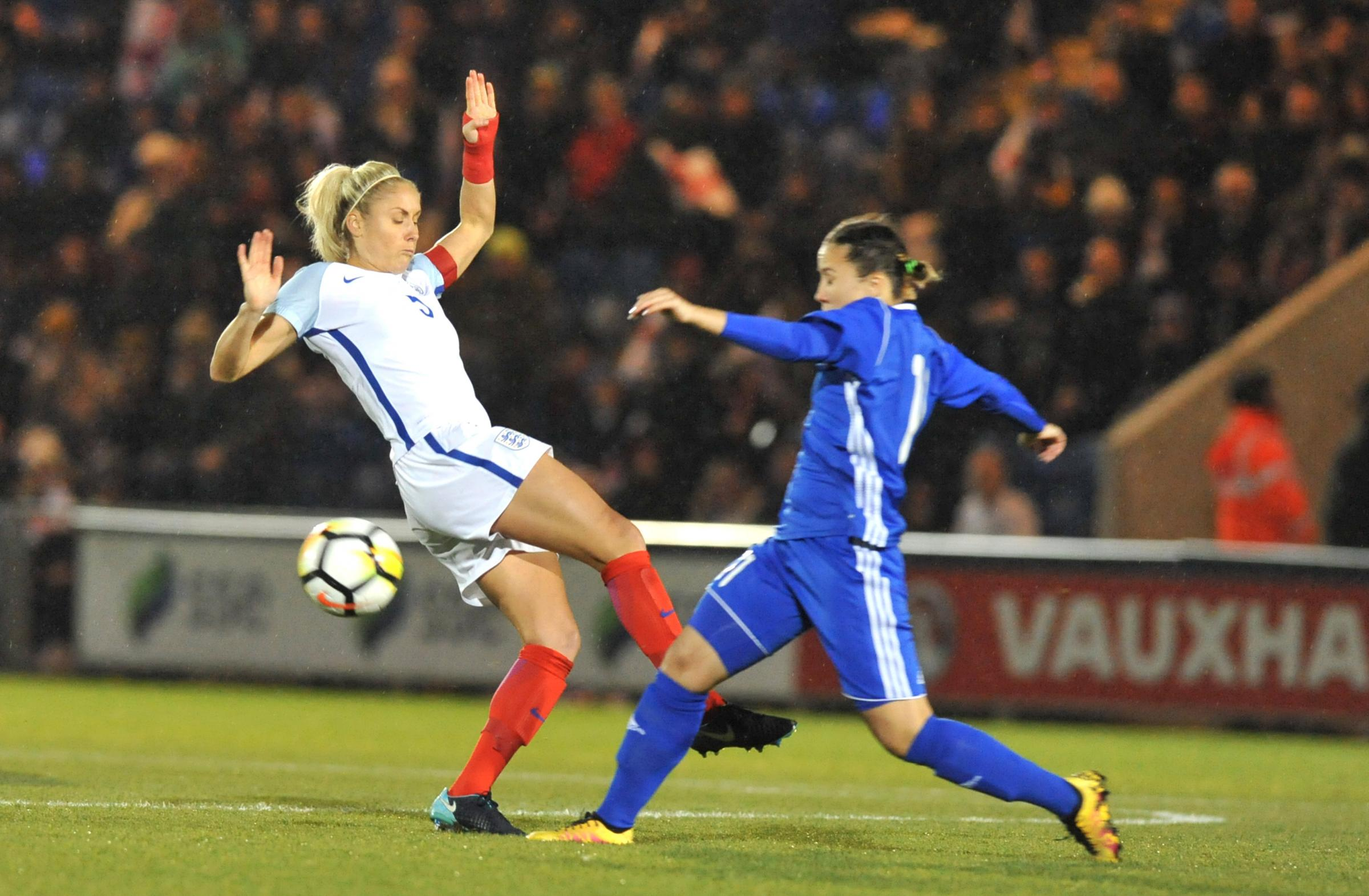 Challenge - England skipper Steph Houghton attempts to win the ball during her side's World Cup qualifier win over Kazakhstan at Colchester United FC Picture: STEVE BRADING