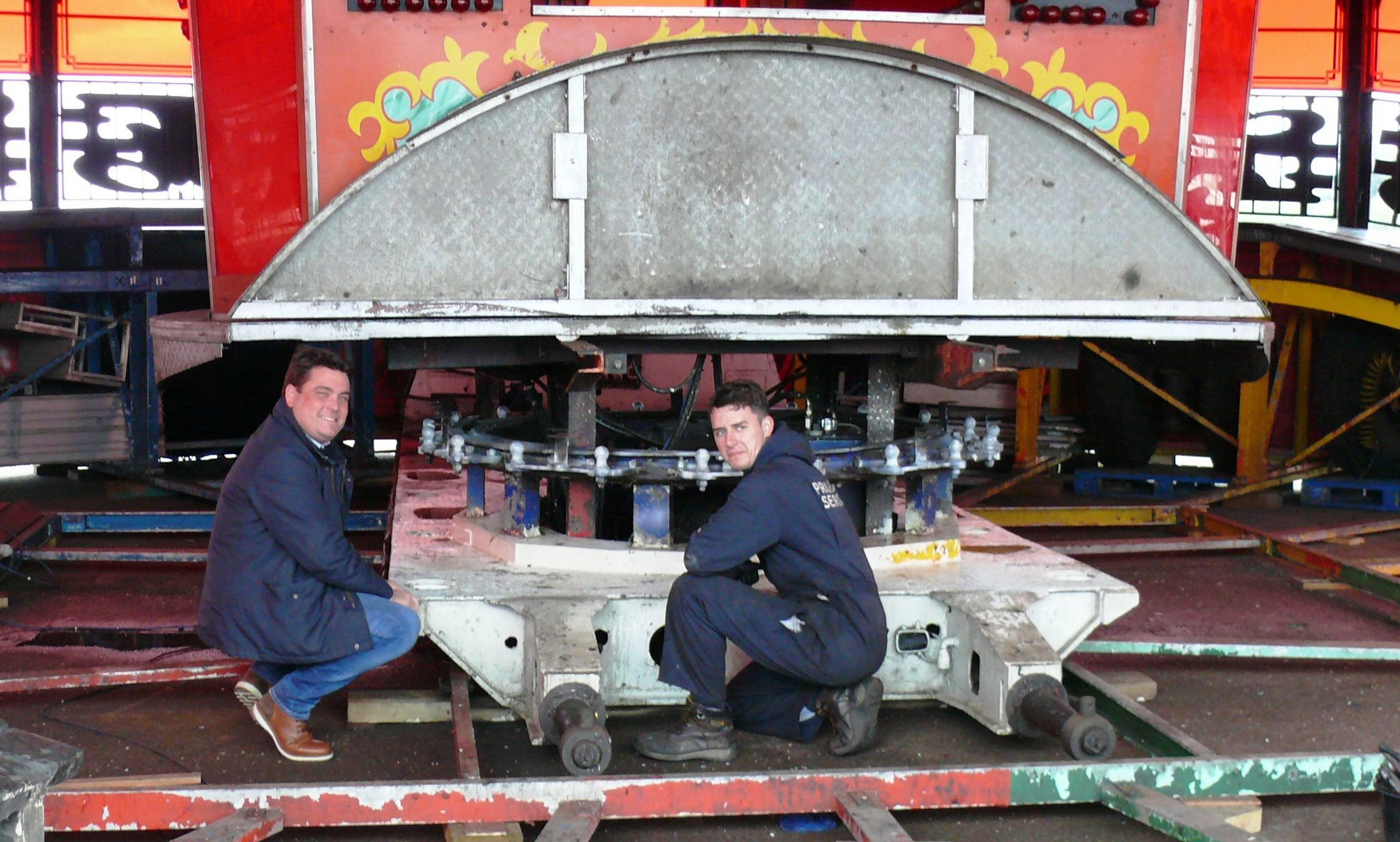 Stripped down - Pier director Billy Ball and engineer Alex Lester with the stripped down Waltzer ready for inspection