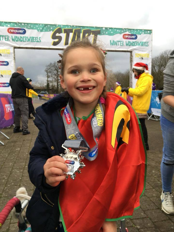 Roxi Aldrich poses with her medal at Winter Wonderwheels