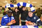 Festive cheer - U's players Sammie Szmodics and Oluwasanmi Odelusi with Kieron and Maddison Larking PICTURE: Rob Howarth