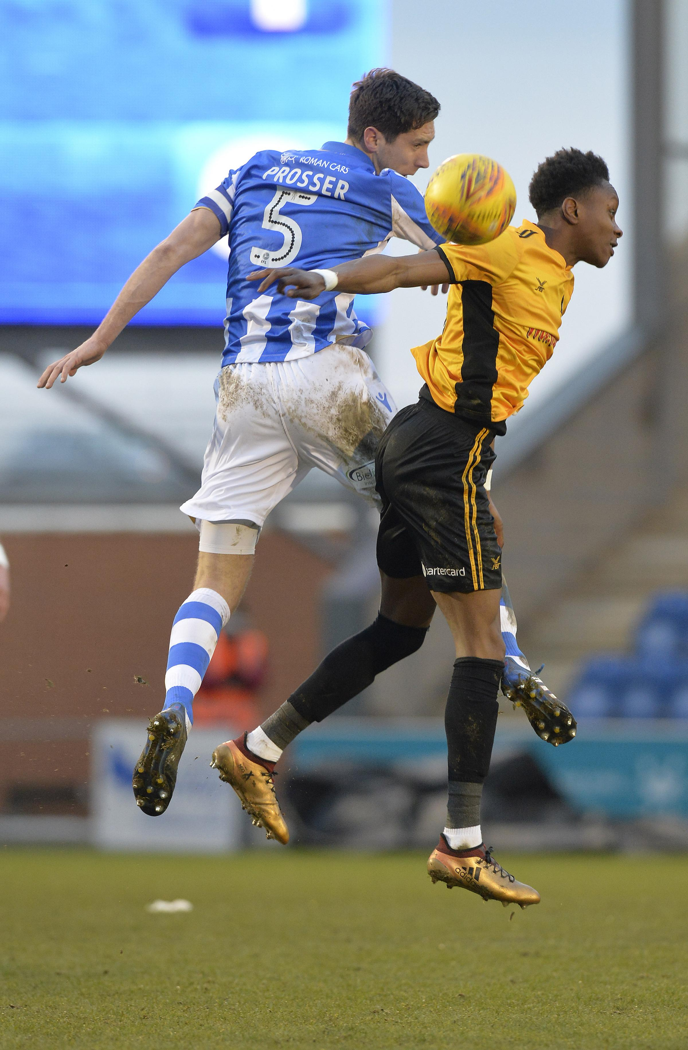 On the up - Luke Prosser rises for a header during Colchester United's 2-0 win over Newport County Picture: STEVE BRADING