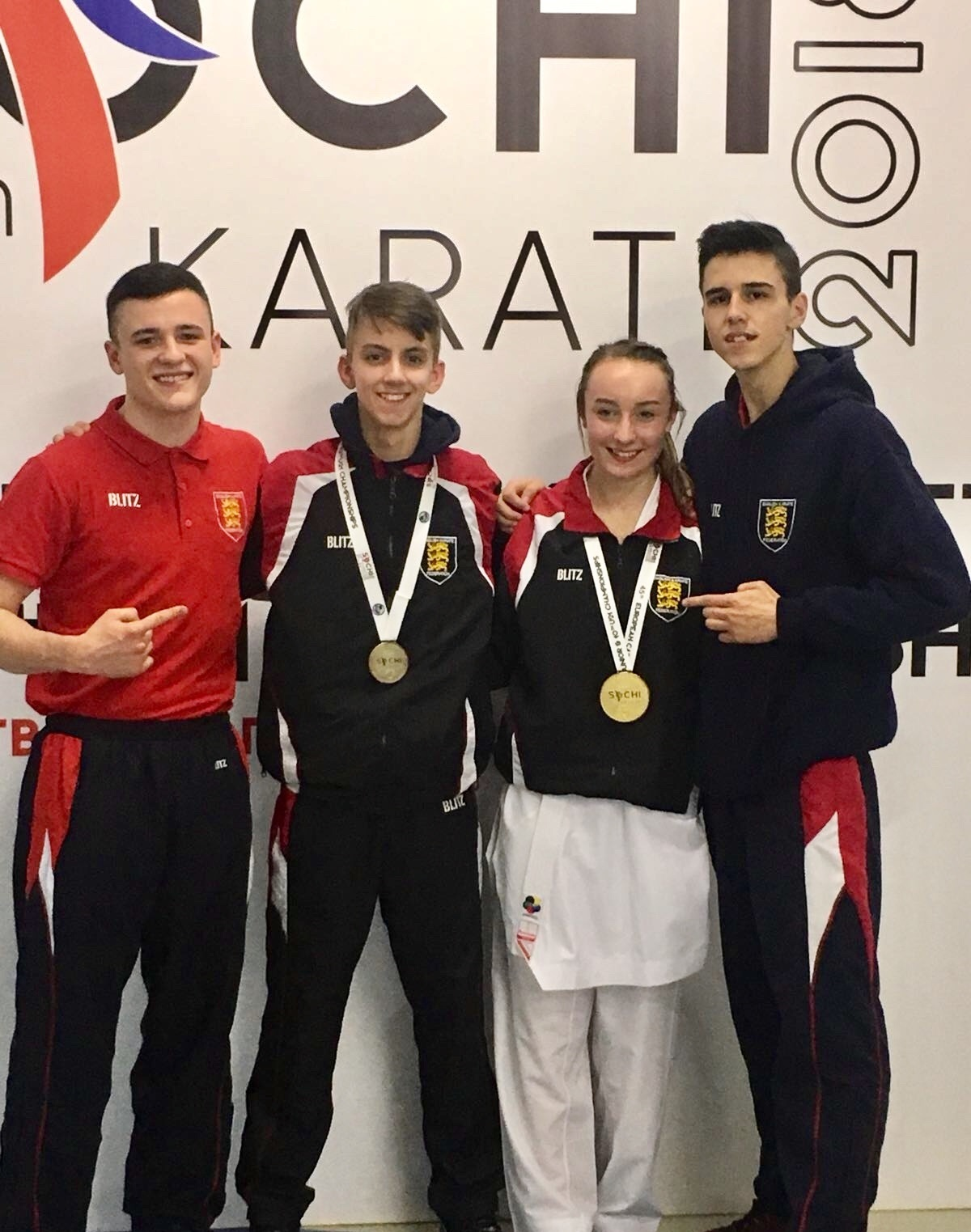 Euro success - Ethan Day and Charlotte Hope (in the middle) are flanked by Links team-mates Mitchell Thorpe (left) and Sam Day, who joined them at the European Karate Cadet, Junior and Under-21 Championships, in Russia
