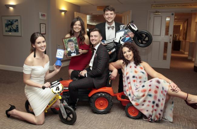 Old pals - Tom's school friends Charly Peek, Holly Morgan, Charlie Morgan, Tom Bailey and Lawren Easter pose with auction items