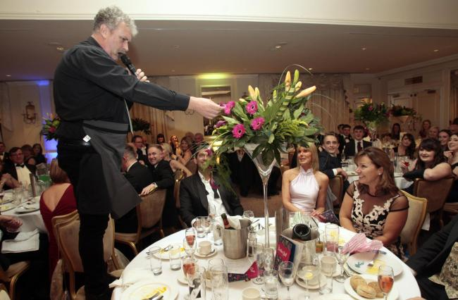 Entertainment - a singing waiter serenades surprised guests