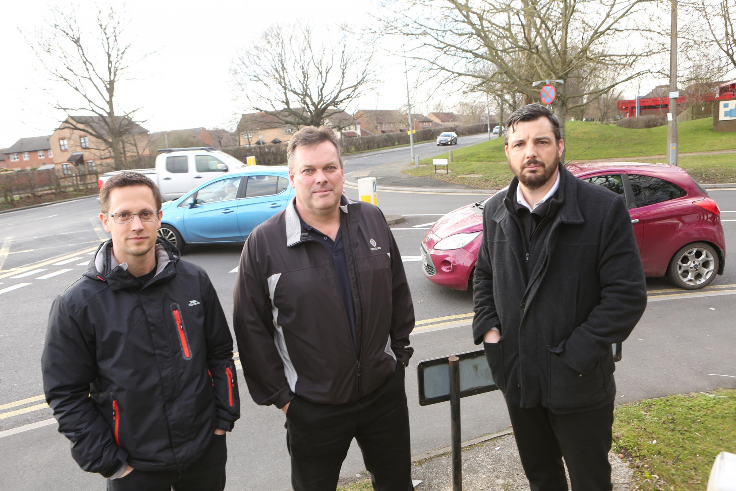Will Johnson and James Hazelton from SES with Scott Gaffney, of BSS, at the junction of Wyncolls Road and Severalls Lane