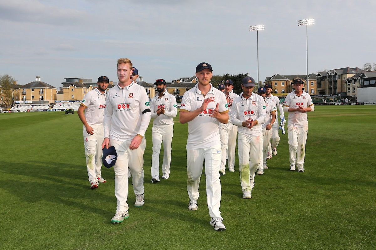 Winning march - Essex players leave the field led by Simon Harmer and Jamie Porter after clinching victory during Essex's victory over Lancashire Picture: GAVIN ELLIS/TGS PHOTO