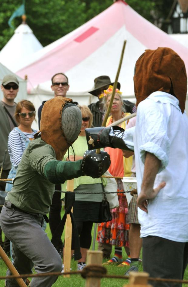 Gazette: Medieval Festival in Castle Park, Colchester..Sward fightling training demo.