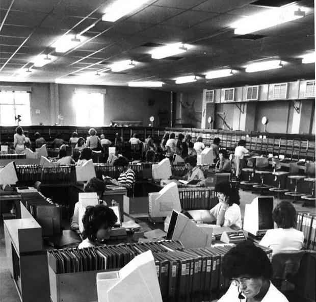 Gazette: The night shoift at work in 1984. The directory enquiries are in the centre of the room..