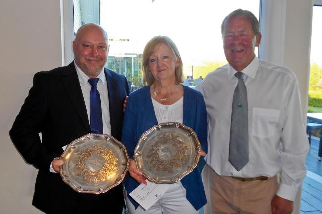 Success - Stoke by Nayland Golf Club duo Del Prichard and ladies' captain Elaine Davidson are presented with the club's Jubilee Salvers trophy by men's captain, Alan Line