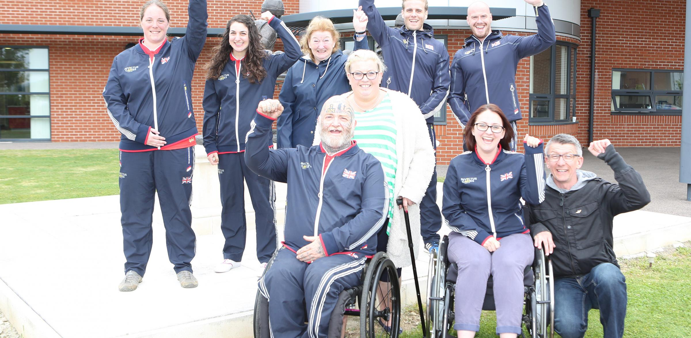 Cheer - the Invictus Games Team GB athletes from East Anglia and the East and West Midlands at the Colchester Recovery Centre. Paul Guest is at the front with wife, Michelle