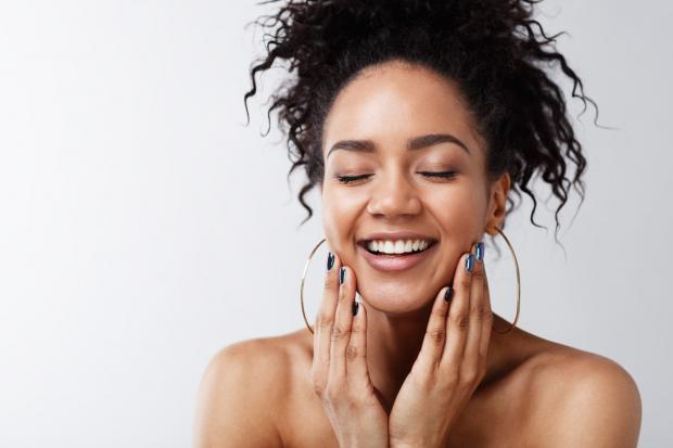 Gazette: A generic photo of a woman with glowing skin smiling and touching her face. See PA Feature WELLBEING Vegetarian. Picture credit should read: PA Photo/thinkstockphotos. WARNING: This picture must only be used to accompany PA Feature WELLBEING Vegetarian