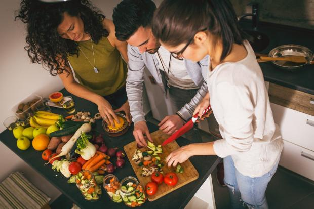 Gazette: A generic photo of a group of friends at the  kitchen preparing together vegetarian meal. See PA Feature WELLBEING Vegetarian. Picture credit should read: PA Photo/thinkstockphotos. WARNING: This picture must only be used to accompany PA Feature WELLBEING