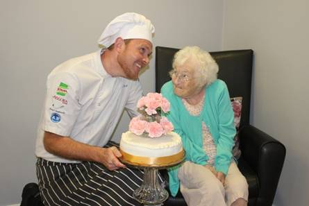 Grace Collins with master chef Paul Rush, of Alderwood care home