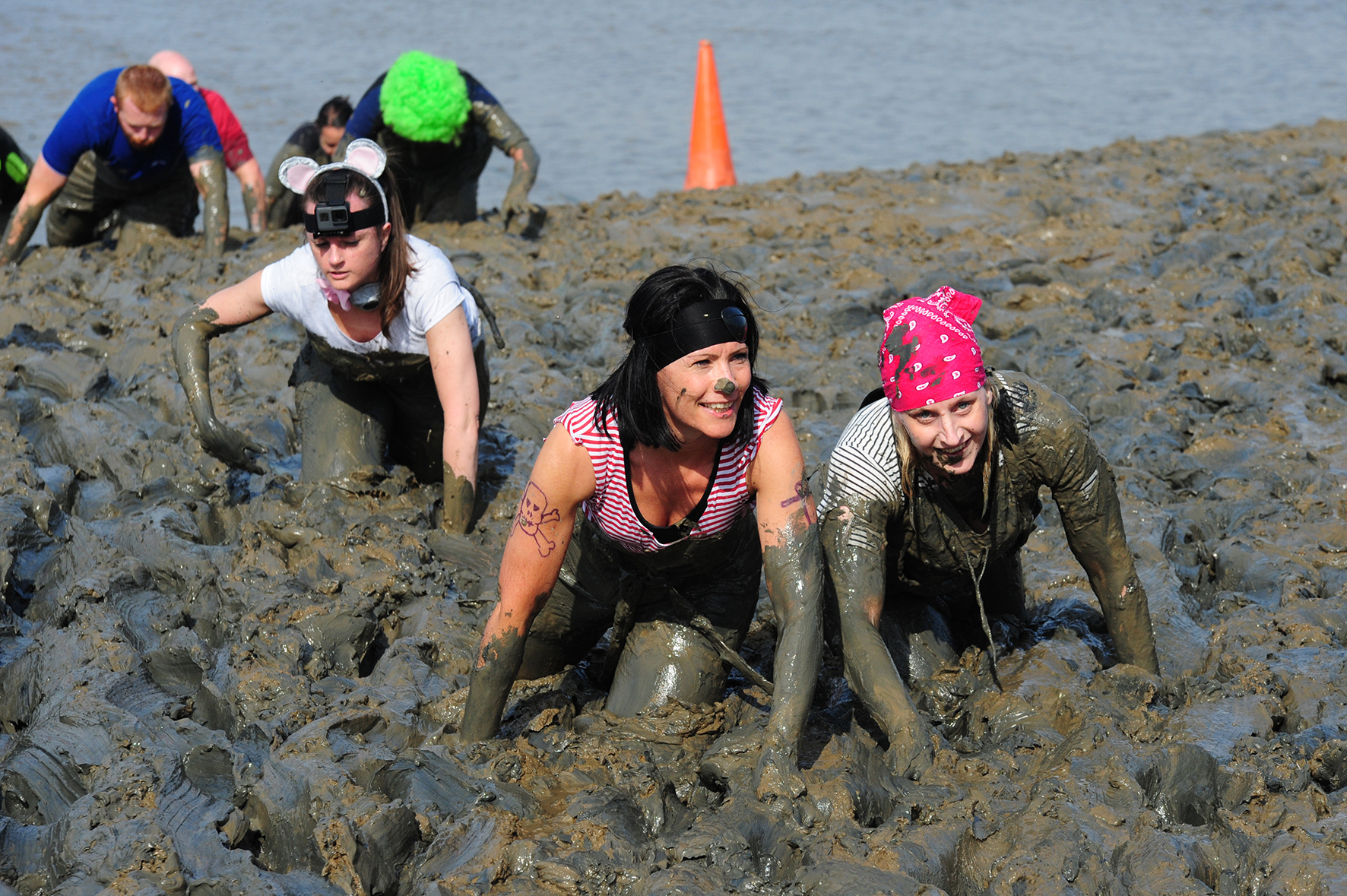 Stuck in: A few participant at last year's Maldon Mud Race wading through the course. In the 2017 race, 300 entrants managed to fundraise more than £35,000