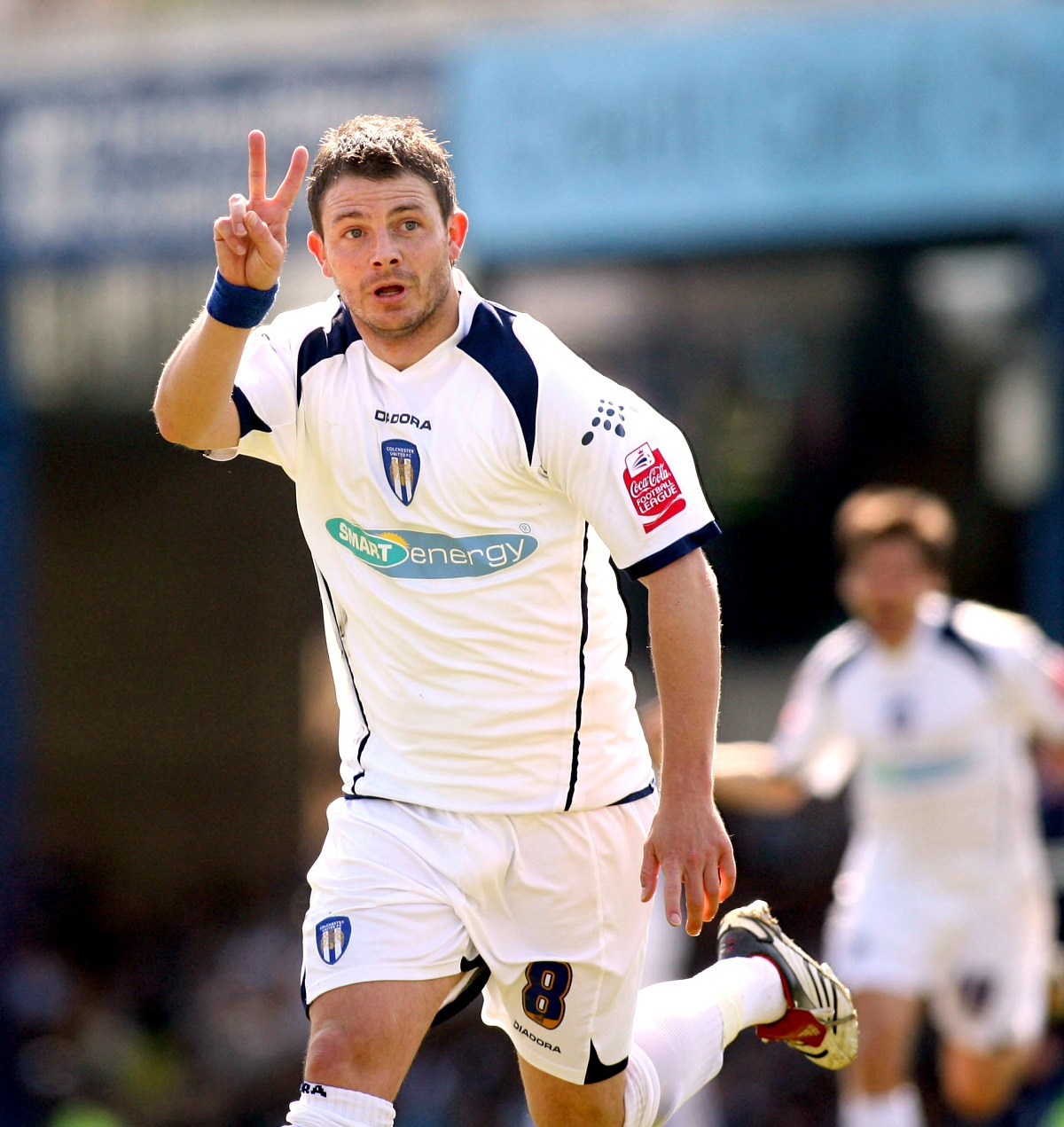 Hat-trick hero - Jamie Cureton celebrates the second of his three goals for Colchester United at Southend United Picture: ROB SAMBROOK