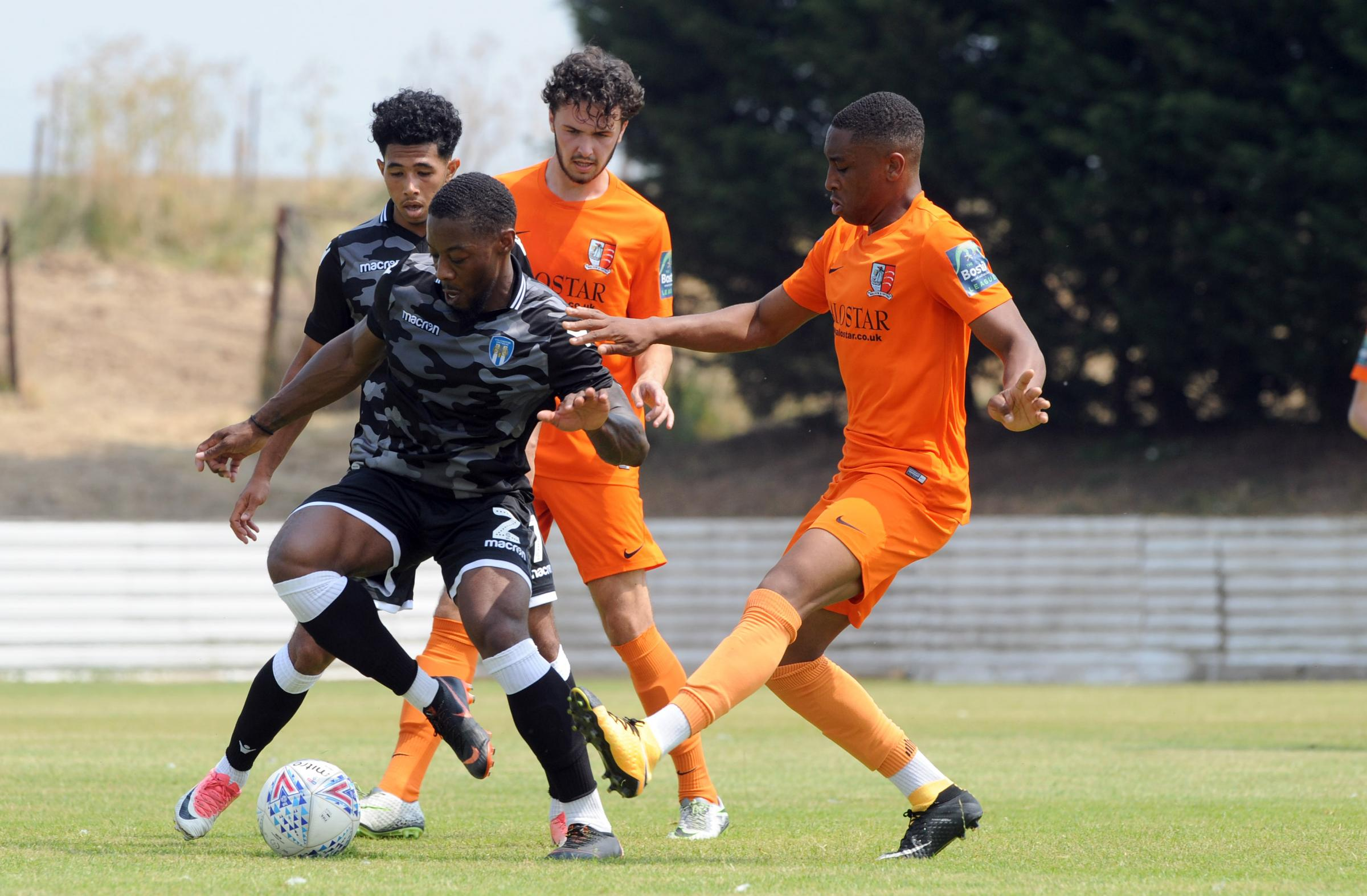 On the ball - Colchester United right-back Ryan Jackson (left) shields the ball in their 4-1 friendly win at Maldon and Tiptree Picture: LUAN MARSHALL