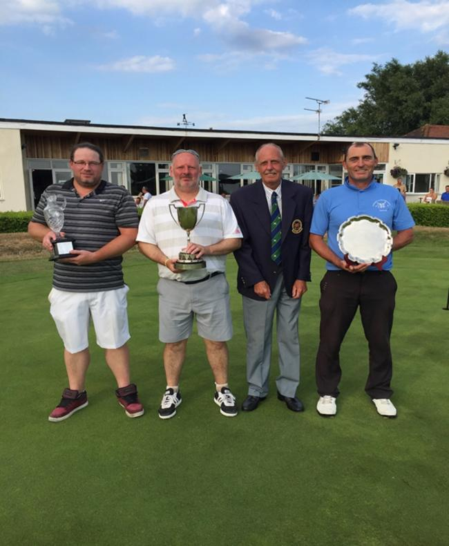 Silverware success - pictured from left are Jamie King, who won the Paul Partridge Trophy, club champion Eric Bushell, club captain Keith Morris and category three and four championship winner Steve Lyons