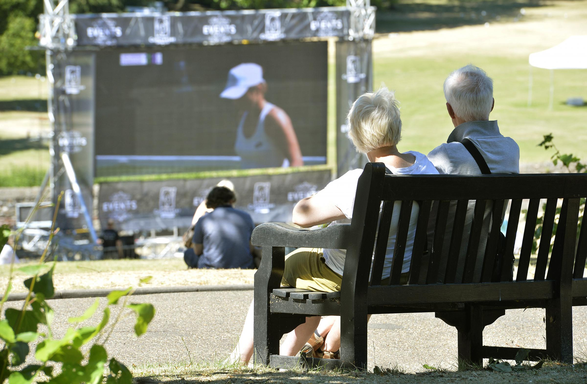 Wimbledon starts in the sunshine and watched in the sunshine in Castle Park, Colchester, on the big screen..