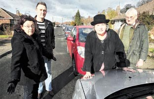 Street patrol – councillors Anne Turrell and Martin Goss with residents John and Jane Chinnery point out the problem of parking in roads near Colchest