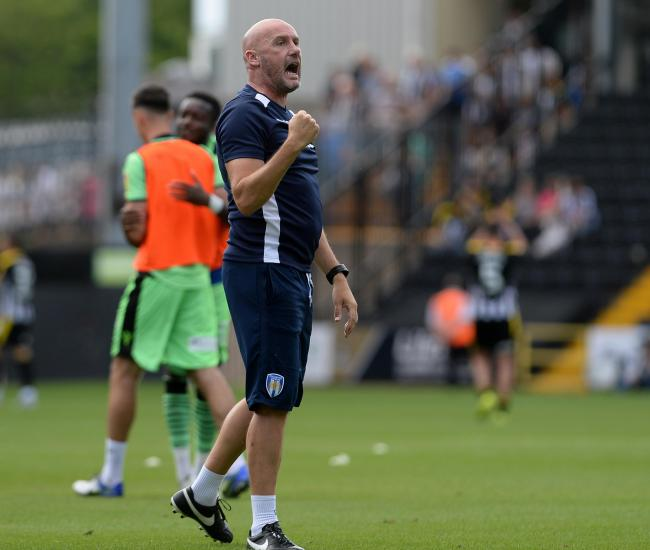 Tough call - Colchester United head coach John McGreal acknowledges the club's supporters following their 0-0 draw at Notts County Picture: PAGEPIX