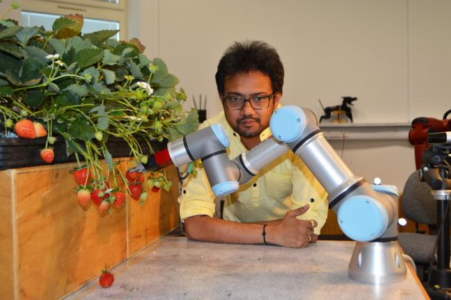 Dr Vishuu Mohan pictured with the machine. Pictures: University of Essex