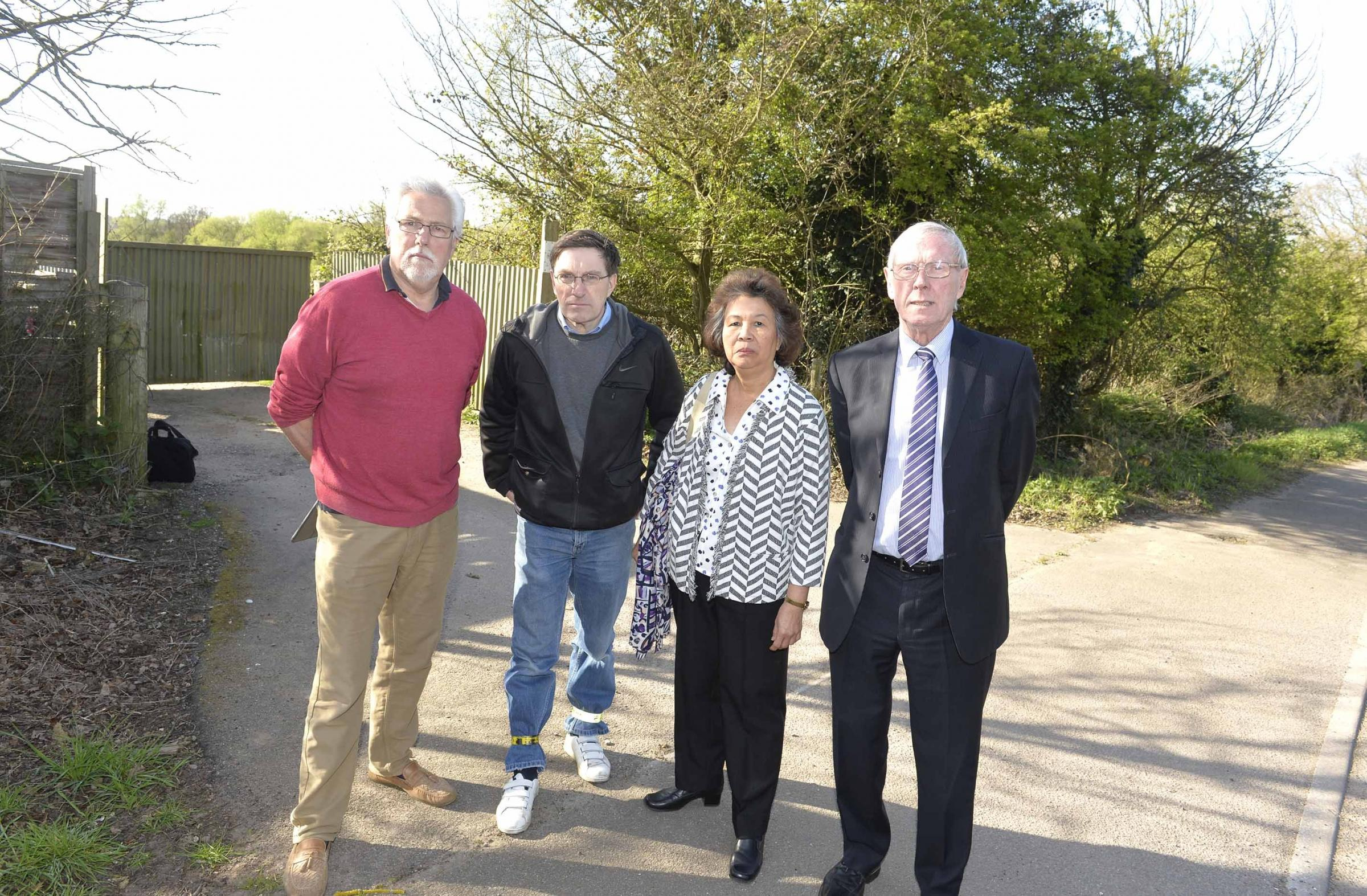 Campaign - Paul Smith, second left, fought to halt the plansColchester Councillors concerned about Tendring plans to develop the Salary Brook area, at Bromley Road end,  which borders onto Colchester.(from left), Mike Hogg, Paul Smith with Helen Chuah a